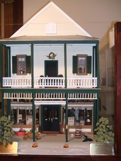 This scale model of the first Post Office and the old Brush Store can be seen in the Interlachen Museum.