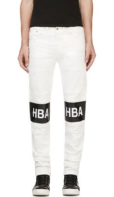 White Denim Logo Tarred Hockey Jeans exclusive for Ssense designed by Hood By Air. Slim-fit jeans in white. Seven-pocket styling. Silver-tone hardware throughout. D-rings at back pockets. Rubberized glossy logo print at front legs in black and white. Tonal stitching. Button fly. http://www.zocko.com/z/JEv1b
