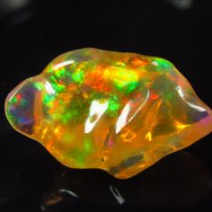 Natural 8.09ct Mexican Crystal Opal free-form Color play Red Green Blue Fiery