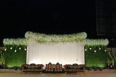 Floral Theme Décor - Package includes entrance décor, stage décor, lighting, furniture including tables and chairs. Dimension: Stage backdrop - 28 feet length x 10 feet height