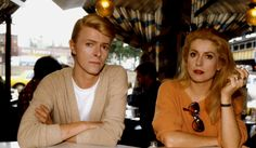 Catherine Deneuve and David Bowie during a break on the set of The Hunger, photographed by Tony Scott, 1982.