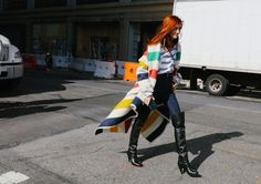 Taylor Tomasi Hill in a Monse shawl, Sacai top, and Khaite jeans