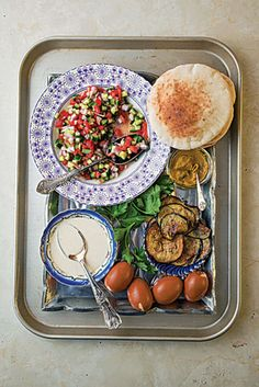 SAVEUR Eggplant and Cucumber Salad Sandwich ~ This Iraqi-Jewish sandwich matches fried eggplant with tahini, hard boiled egg, and chopped fresh tomato and cucumber salad. Cucumber Recipes, Cucumber Salad, Veggie Recipes, Kirby Cucumber, Vegetarian Recipes, Vegetarian Sandwiches, Picnic Recipes, Picnic Ideas, Tomato Salad