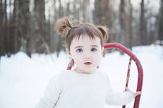 Winter toddler portrait with old red chair. Photo by Brome and Timothy Photography 2016