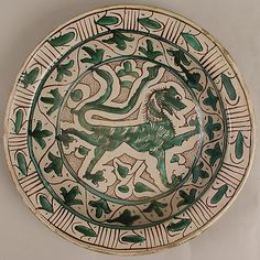 Wouldn't be hard to make this a gryphon  Dish    Date:      early 15th century  Geography:      Made in, Tuscany, Italy  Culture:      Italian  Medium:      Earthenware, tin-glaze (Majolica)  Dimensions:      Overall: 3 x 14 3/4 in. (7.6 x 37.5 cm)  Classification:      Ceramics  Credit Line:      Fletcher Fund, 1946  Accession Number:      46.85.3