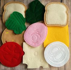This 10 piece sandwich set is made from acrylic felt on my embroidery machine. The 2 pieces of bread are tan and ivory on each side. Next are 1 slice each of cheddar and Swiss cheese, an onion slice, tomato slice, leaf of lettuce, group of 3 pickles, slice of ham, and slice of bologna. The sandwich ingredients are embroidered on one side and plain on the other. Each ingredient is about 4.24 across and when all stacked are 1.75 tall. Would you prefer different quantities? Just message me! I…