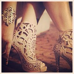 ....yeeeeeouch!! laser cut leather heels