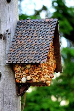 Lovely-DIY-birdhouse with pebbles and copper penny roof.