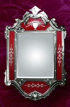 I have a similar mirror shaped like a heart instead of a rectangle. It is for sale $200.