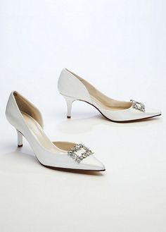 b8e3f3a68646d Satin Caparros d orsay mid heel pump features dazzling rhinestone ornament  detail on the face of the shoe.