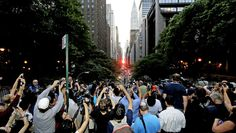 Manhattanhenge, sometimes referred to as the Manhattan Solstice, happens when the setting sun aligns with the east-to-west streets of the main street grid. 42nd Street, New York Street, New York City, Manhattan Henge, Hayden Planetarium, City Grid, Forced Perspective, New York Photography, City Hunter