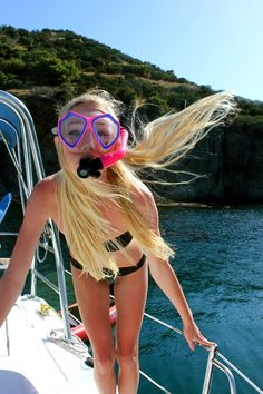 no one looks cute in goggles and a snorkel but this girl manages to do it.