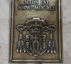Bronze memorial plaque of Primate Jan Lipski (1589-1641) of Łada coat of arms from about 1647, closing the entrance to the funerary crypt under the chapel of the Blessed Sacrament in the aisle of the Łowicz Cathedral. © Marcin Latka #17thcentury #artinpl #baroque #coatofarms