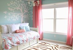 Ok we love this!! Agua wall coral curtains but with a grey and white chevron rug