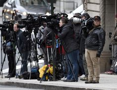 P hotographers stand at the intersection of Calvert and Fayette Streets near the Mitchell Courthouse, on the first day of the trial of Officer William Porter.