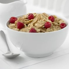 Cereal topped with raspberriesprimamagazine