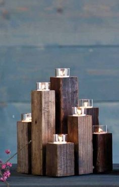 What a simple  elegant way to display tea light votives...simple, easy  cheap, just cut some 2x2s and stain