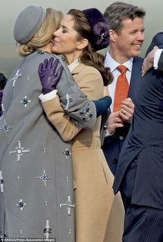 Warm embrace: Mary shares a hug with the Netherlands' popular Queen Maxima...