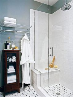 Elegant Escape  Open Design  Tall clear-glass shower doors emphasize the small bath's high ceilings and create the illusion of more room. The white subway tile and chrome fixtures reflect light contributing to the sense of spaciousness. Basket-weave tile covers the floor and carries into the shower for continuity.