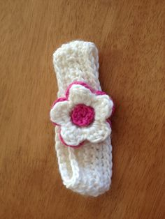 Girls crochet headband/ear warmer with flower detail. Off white headband with hot pink and off-white flower detail. Other colours available. on Etsy, $12.00 AUD