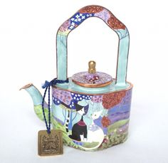 Micio and Micia cats by Rosina Wachtmeister, featured on a miniature enamel teapot by Charlotte di Vita; nivagcollectables.co.uk
