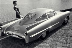 1954 Oldsmobile Cutlass Concept | Presented at the 1954 Motorama by General Motors | It took its name from the military Chance-Vought Cutlass, a Navy fighter plane | The aviation theme was prevalent throughout the Cutlass. Instrumentation resembled aircraft instruments