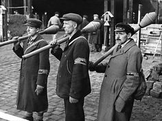 "German members of the Volkssturm (roughly, ""People's Militia"") with faustpatrone (cheap, single shot, recoilless German anti-tank weapon which was essentially a smaller version of a panzerfaust) stand at attention during training. Berlin, 10 March 1945."