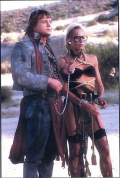 """Roddy Piper and Sandahl Bergman in """"Hell Comes to Frogtown"""" Sandahl Bergman, Roddy Piper, Conan The Barbarian, Wrestling Wwe, Brain Dump, Ultimate Collection, Beautiful Person, Geek Culture, Science Fiction"""