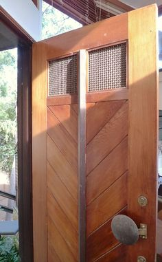 [Project: Cottage Point] Feature timber with woven mesh window detail and oversized brass and bronze handle Lift Design, Window Detail, Steel Columns, Wooden Poles, Mesh Screen, Architectural Features, Luigi, Architects, Chevron