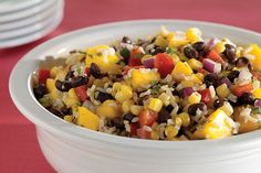 This Caribbean-inspired salad of brown rice, black beans, corn and mangos is seasoned with lime juice, cumin and cilantro for a taste of the tropics.