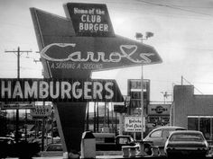 Businesses, including Carrol's, and their signs along