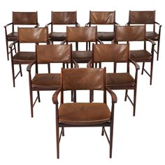 Set of 10 armchairs in rosewood and original leather by Kai Lyngfeldt Larsen | From a unique collection of antique and modern dining room chairs at http://www.1stdibs.com/furniture/seating/dining-room-chairs/
