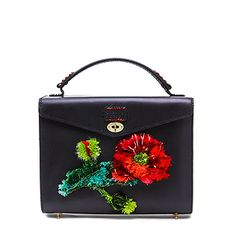 Black vegetable tanned leather handbag with 3D poppy embroidery handcrafted in the Yunnan and Dali region. Made in England.