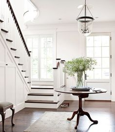 Dark wood steps to contrast white. Also like the pale subtle rug