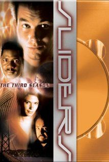 "Sliders (TV Show): A genius college student discovers a way to ""slide"" between alternate universes, and accidentally drags his girlfriend, his professor, and a random stranger along for the ride. Together they search for a way to return to their own universe."