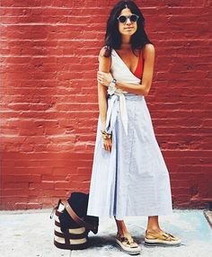 Leandra Medine aka Man Repeller puts together an amazing beach outfit idea. A bathing suit and skirt styled with Prada Sandals, Trademark handbag and Zanzan sunglasses. Like it? (Photo credit: Man repeller)