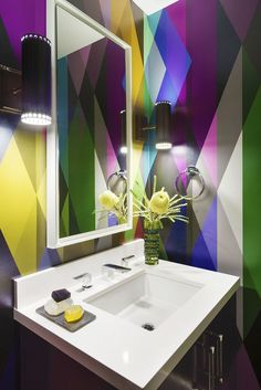 Modern bathroom with technicolor geometric wall paint pattern