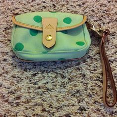 Authentic Dooney & Bourke wristlet Celery colored D&B flap wristlet. Never used. Green polka dots and gold hardware with leather strap. Dooney & Bourke Bags Clutches & Wristlets