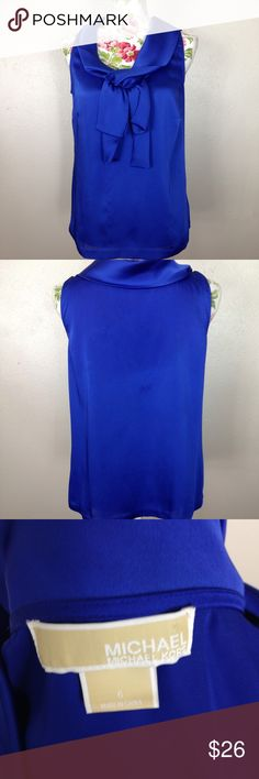 Sleeveless Michael Kors blouse Does have a couple slight flaw's two spots that will need a dryclean to get out and a pull in the front as shown in picture MICHAEL Michael Kors Tops Tank Tops