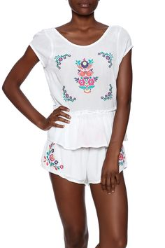 White gauzy cap sleeve top with a loose peplum bottom and colorful floral embroidery.    La Lune Top by MinkPink. Clothing - Tops - Tees & Tanks Clothing - Tops - Short Sleeve Clothing - Matching Sets New York