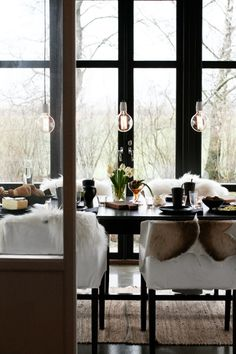 Dining room ~ a bit furry for my taste but I like the lights and windows
