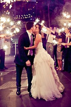 Sparklers! - wedding photography - bride and groom kissing