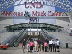 A group of attendees from our 2010 High School Sports Marketing Conference stops to pose for a quick picture outside of the Thomas & Mack Center on campus at UNLV before our presentations and tour.