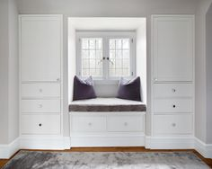 Bright white built-in cabinets offer storage without taking up any space in a neutral contemporary bedroom. A cozy window seat is decorated with a gray cushion and pillows that bring out the gray throw rug. Bedroom Built In Wardrobe, Bedroom Built Ins, Bedroom Closet Design, Master Bedroom Closet, Bedroom Furniture Design, Bedroom Storage, Bedroom Decor, Small Closet Design, Small Space Interior Design