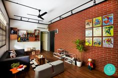Contrast white walls with one striking red brick wall. Put up vintage superhero signs to add quirk and colour. #redandwhite #brick #wall