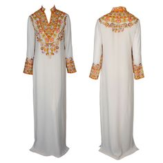 A chic white floor-length Kaftan dress with embroidered sleeves and a Mandarin collar by Mynahs #kaftan #brocade #gbmoda