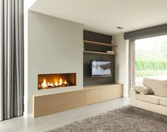 Gas fireplace in the entire wall with oak cupboard shelf Gas fireplace in the entire wall with . Gas fireplace in the entire wall with oak cabinet shelf Gas fireplace in the entire wall with oak c Tv Above Fireplace, Linear Fireplace, Home Fireplace, Modern Fireplace, Fireplace Design, Living Room With Fireplace, Wall Mounted Fireplace, Living Room Tv, Living Room Modern