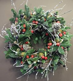 Frosty Pine and Apple Christmas wreath by Phillo Flowers in Notting Hill, London UK