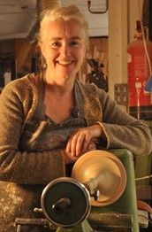 Sarah Lock makes wood turned and hand painted lamp bases.