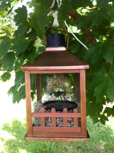 This candle lantern was 'trash' due to a broken window pane. But a Popsicle fence, a dollar store paper clip holder, moss, and solar garden light make this an adorable lighted bird feeder gazebo! Popsicle Stick Birdhouse, Candle Lanterns, Candles, Primitive Garden Decor, Broken Window, Diy Bird Feeder, Bird Houses Diy, Trash To Treasure, Gazebo